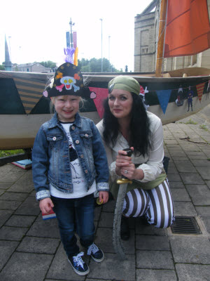 chloe-hurdiss-collects-her-treasure-trail-prize-from-pirate-leader-elaine-stott